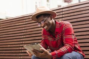 Young man looking on tablet looking at ChooseFI Resources