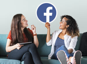 Two girls exploring Facebook to find ChooseFI cohort groups